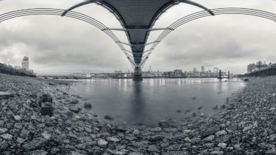 Under The Bridge - View of the RIver Thames and London Skyline from underneath the Millennium Bridge. London Black & White Fine Art Photographic Print